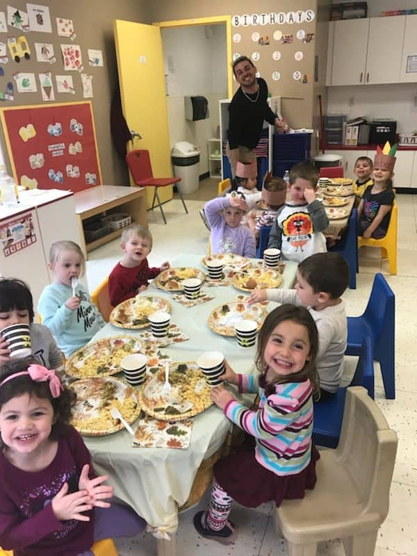 smiling tutor and children at thanksgiving lunch