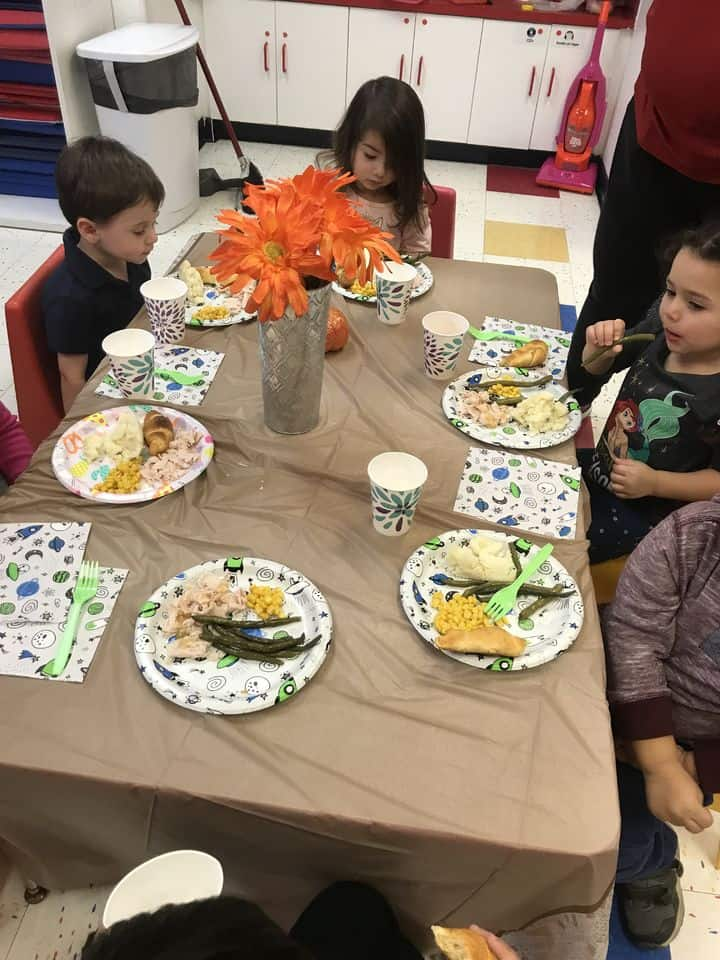 smithtown tutor time's thanksgiving dinner children in the lunch room