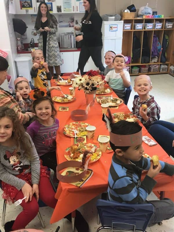 classroom orange cloth thanksgiving table children enjoying lunch
