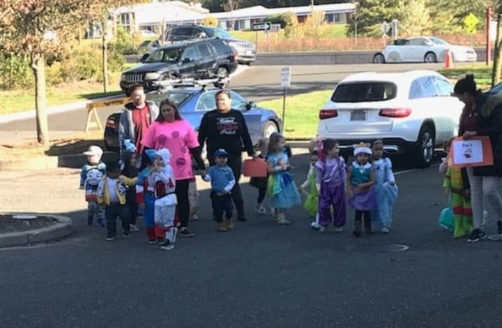 family group arriving for halloween at smithtown tutor time