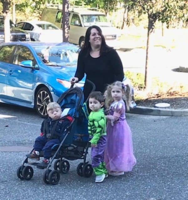 mother and children pose for halloween photo