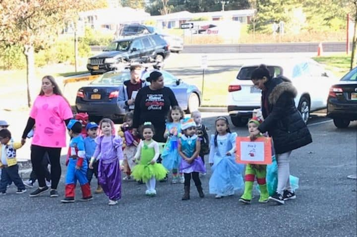 parents & children arriving for halloween smithtown